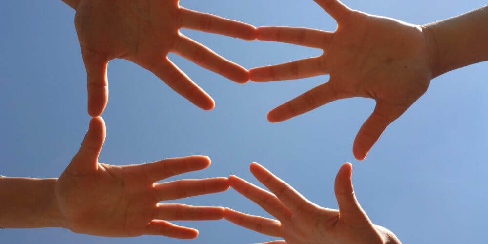 hands reaching across to make mediation at gold coast family mediation
